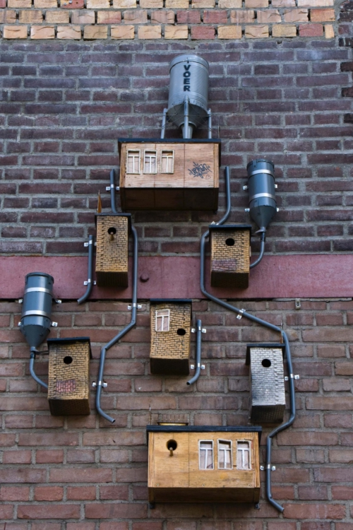 Nestkastjes aan muur Honig Nijmegen